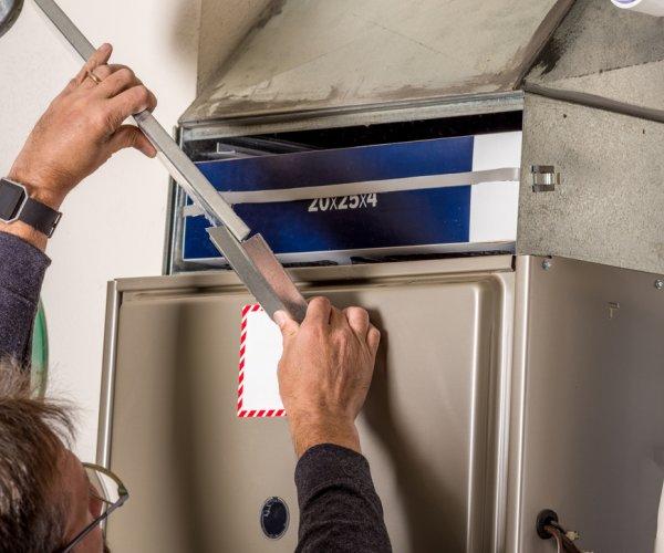 HVAC technician replacing a heater in Phoenix
